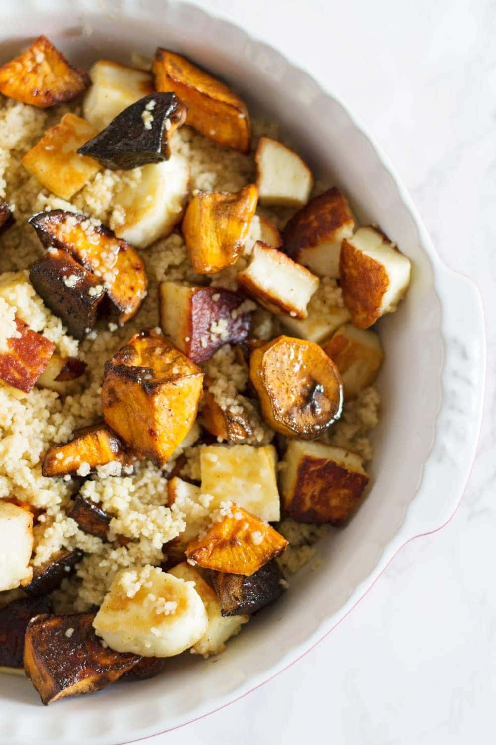 This vibrant halloumi, sweet potato and bulgur wheat salad is full of saltiness from the halloumi and olives and creamy sweetness from the sweet potato.