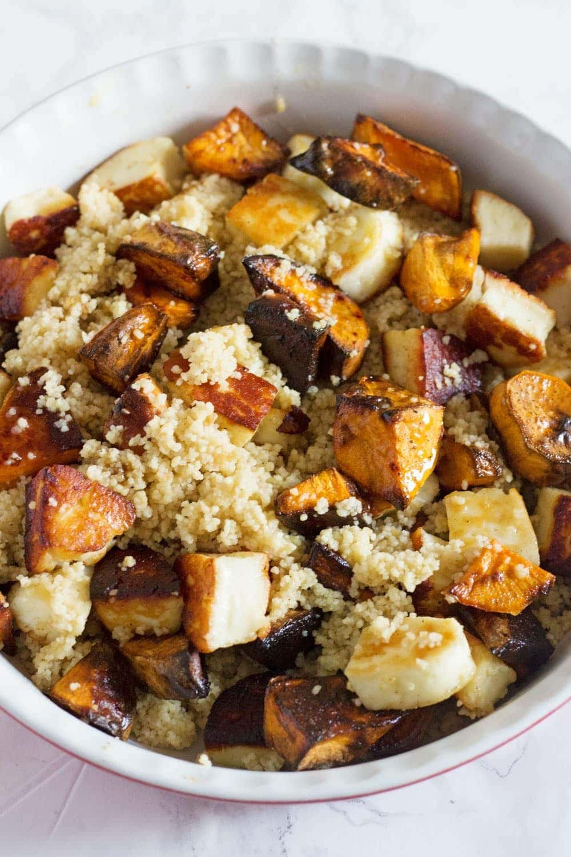 This vibrant halloumi, sweet potato and bulgur wheat salad is full of saltiness from the halloumi and olives and creamy sweetness from the sweet potato.