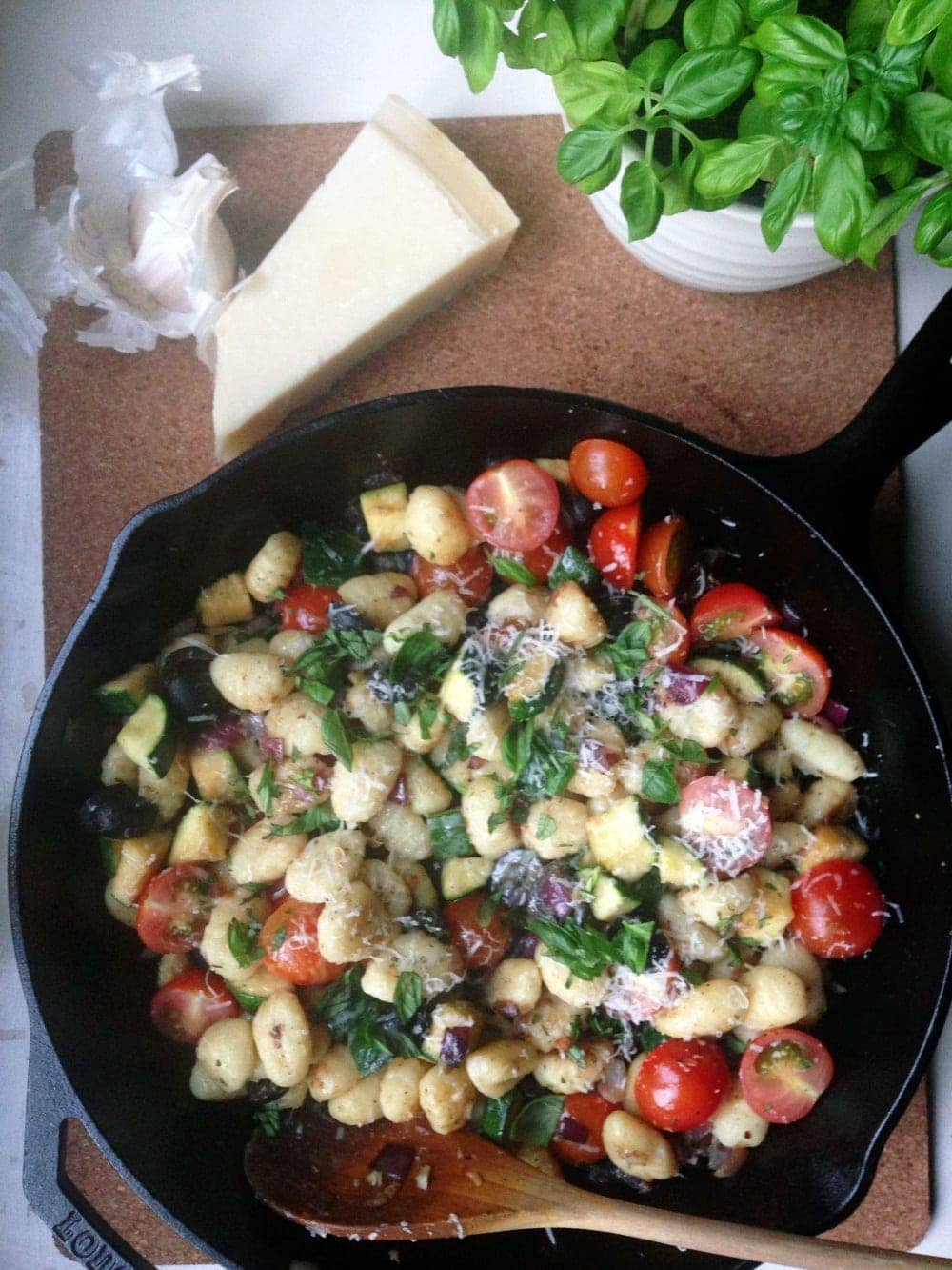 This summer gnocchi skillet is full of fresh vegetables and chewy pillows of gnocchi. It only takes one pan and can come together in half an hour.