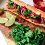 This Korean pork banh mi has meatballs cooked until crisp on the outside then topped with gochujang mayo, carrot, cucumber and quick pickled onions.