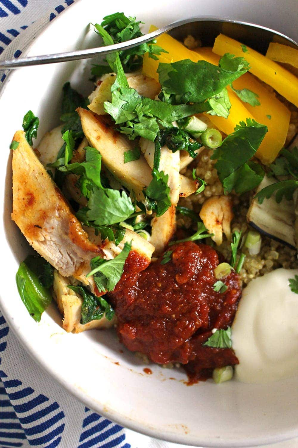 These chipotle chicken quinoa bowls are perfect for using up leftover roast chicken. A simple and healthy dinner, use any veg you have and make it your own.