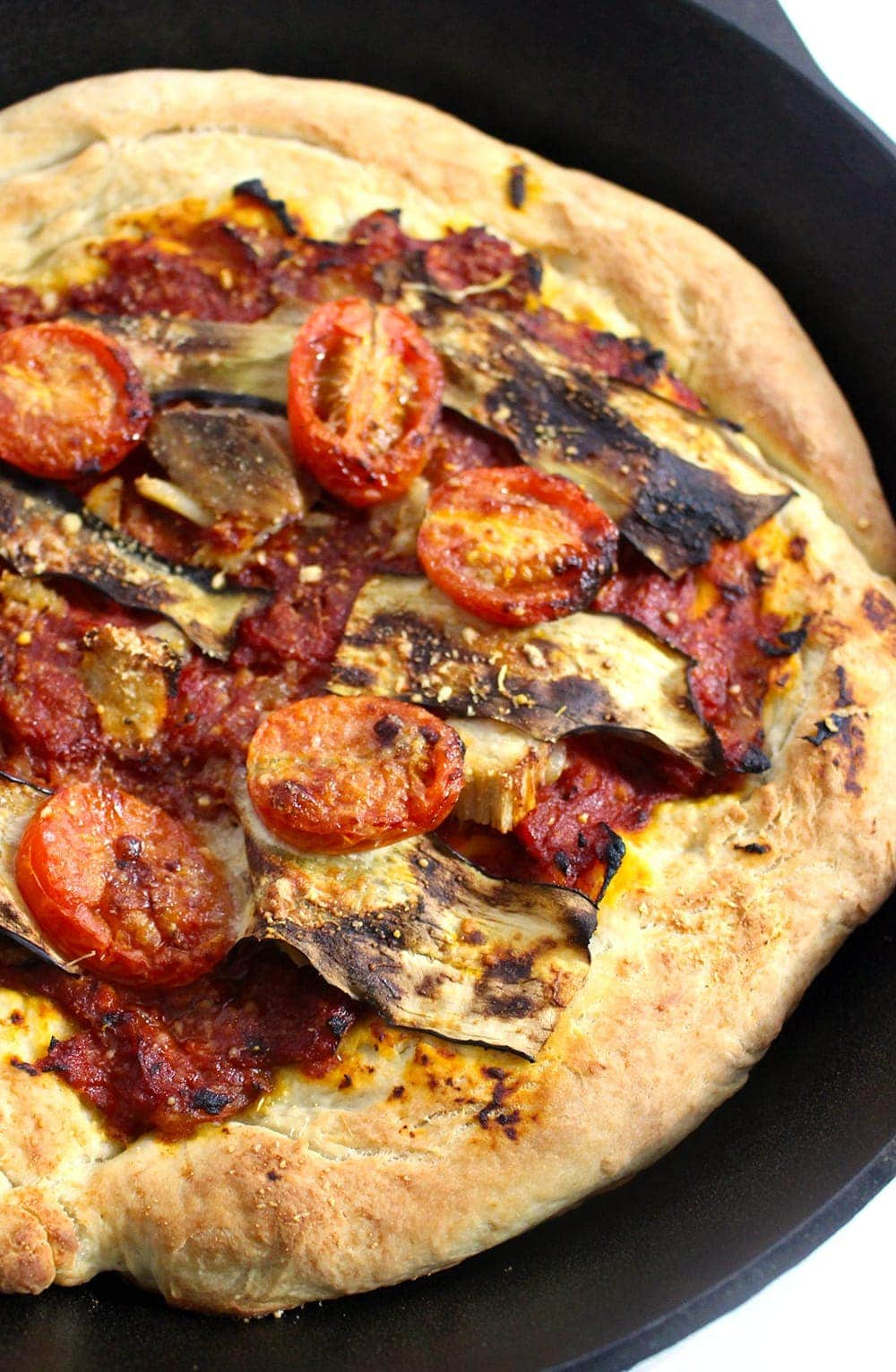 This roasted garlic, pork & aubergine pizza is the perfect combination of garlicky, meaty, salty goodness. It's perfect for using up leftover roast pork!