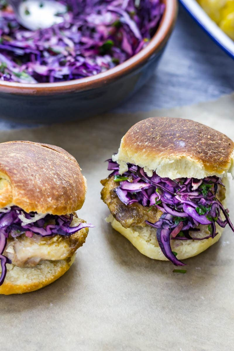 Cumin Rubbed Chicken Sandwich, Chimichurri Slaw & Chipotle Potato Salad. This cumin rubbed chicken sandwich is served with a delicious herby chimichurri slaw and a spicy chipotle potato salad! #chickensandwich #chicken #recipe