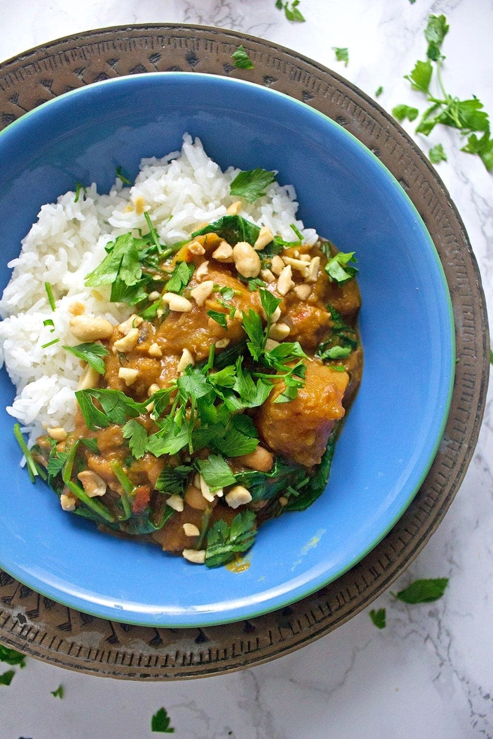 This butternut squash peanut stew is a great winter warmer. The peanut gives it a wonderful creaminess which you won't be able to get enough of!