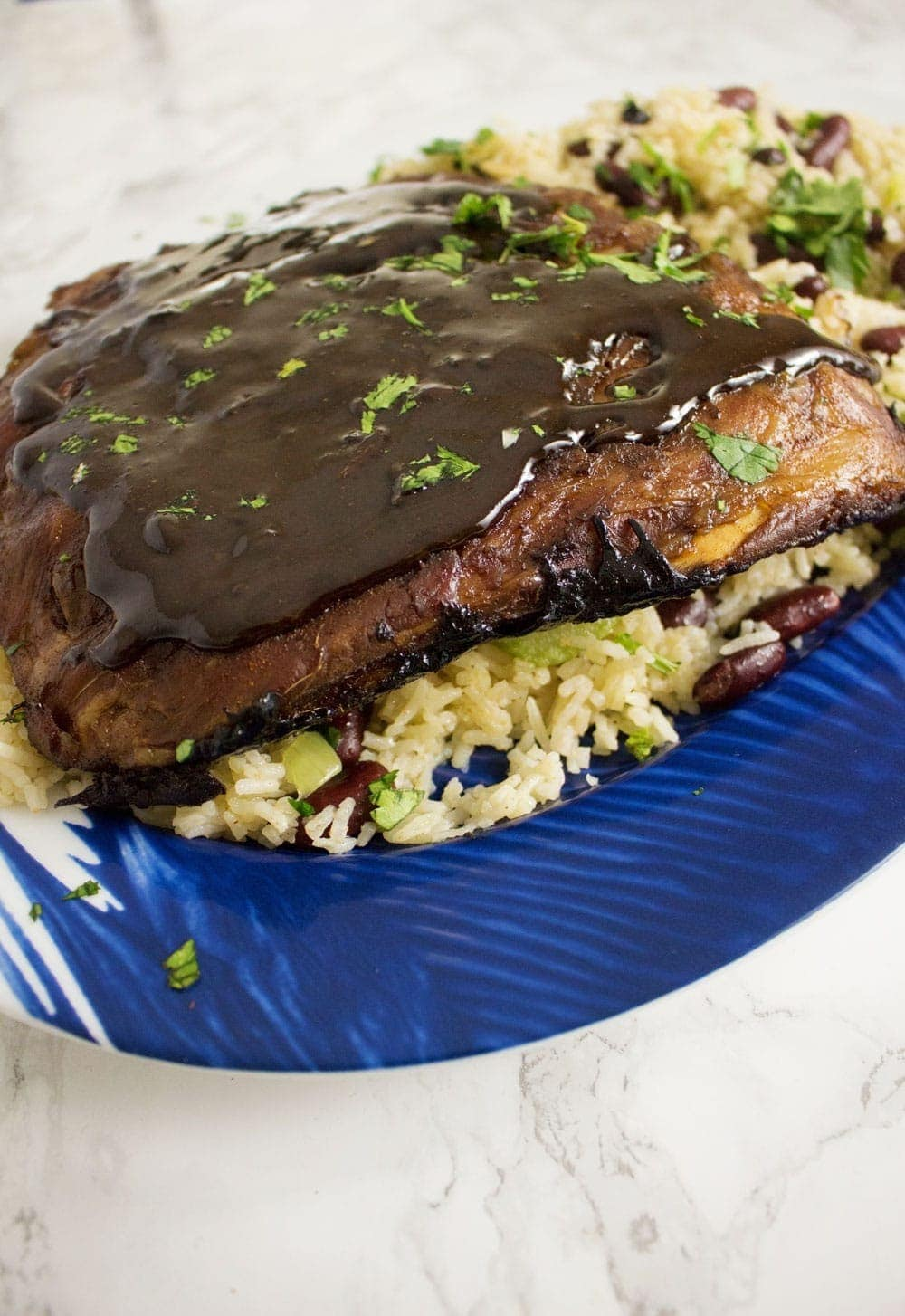 These sticky oven baked Cajun pork ribs are the perfect autumn dinner. Made with a brown sugar and spice dry rub and cooked in a flavourful braising liquid.