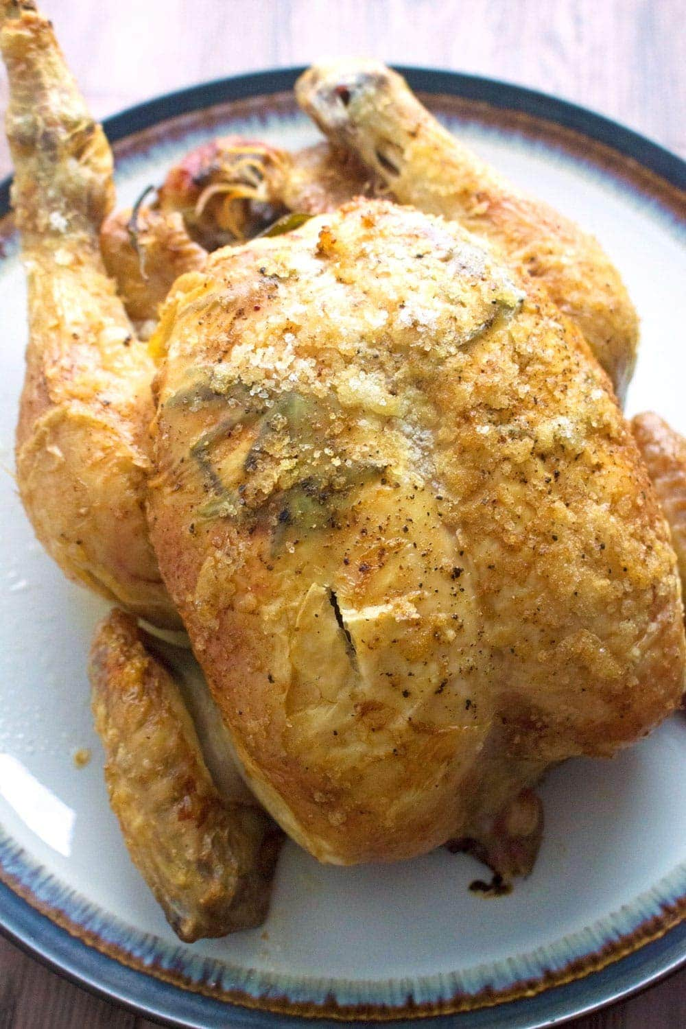 Perfect roast chicken with rosemary lemon garlic the for Roast chicken uk