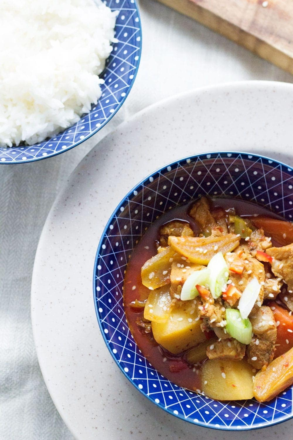 This Korean pork & potato stew is full of warm, spicy flavour. Slow cooking it makes the meat fall apart. It's the perfect winter warmer.