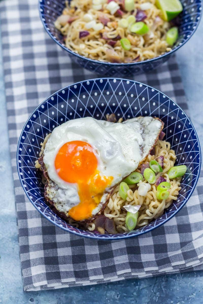 Noodles with a runny egg on a checked cloth
