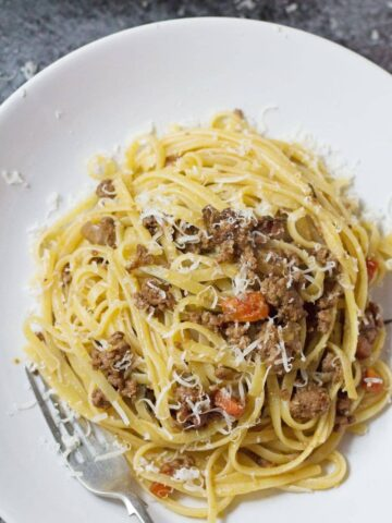 This veal & pancetta ragu is slow cooked for over an hour to get the meat insanely tender. This recipe makes a delicious change from beef.