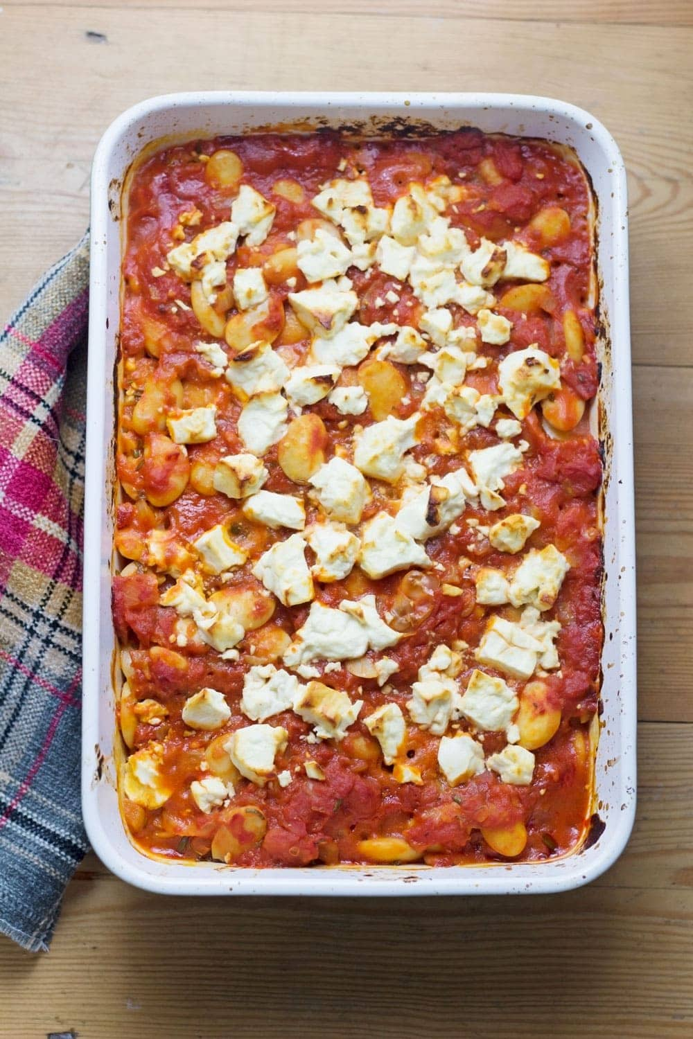 These baked white beans are cooked slowly with feta crumbled over the top then served with garlicky yoghurt and a drizzle of homemade chilli butter.