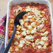 These baked white beans are cooked slowly with feta crumbled over the top then served with garlicky yoghurt and a drizzle of homemade paprika butter.