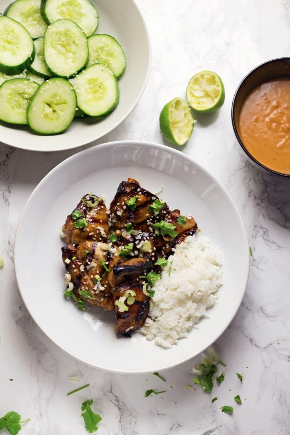 This grilled chicken with peanut sauce is served with a cooling sesame cucumber salad. The recipe requires minimal fuss and feels super indulgent!