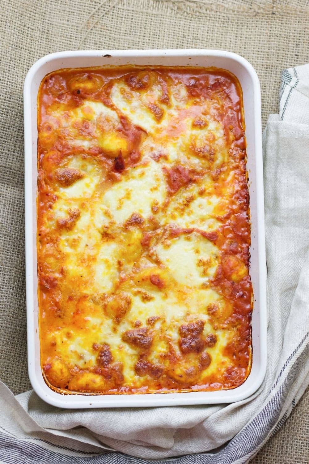 This cheese and tomato baked gnocchi is the perfect comfort dinner! Serve up a bowlful when you need a pick-me-up and you'll feel better in no time.