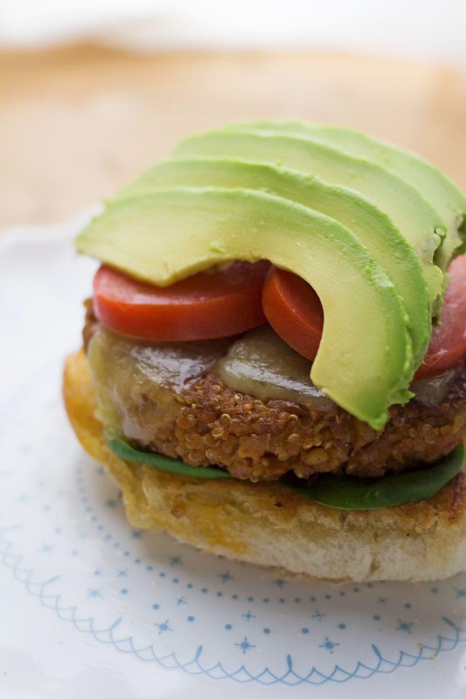 Avocado slices on top of chickpea veggie burgers