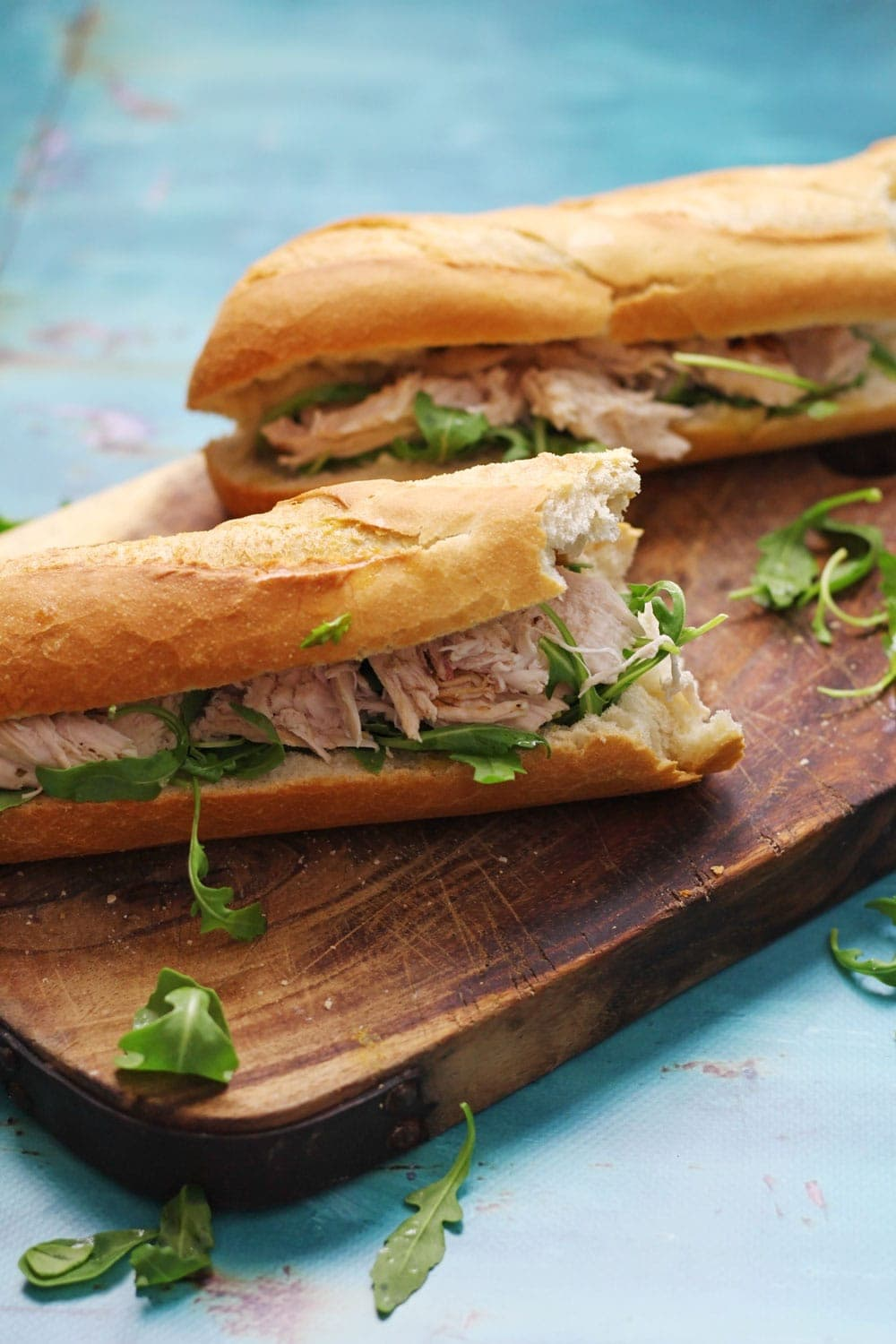 This lime & mint roast chicken sandwich recipe is a delicious weekend treat! Serve drizzled with garlic butter and topped with peppery rocket leaves.