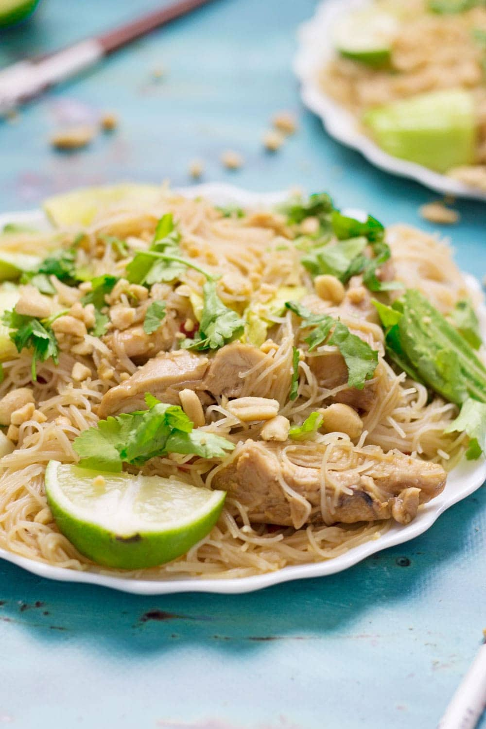 Close up of Thai chicken noodles on a blue background
