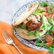 These Moroccan meatball flatbreads are surprisingly quick to make. The meatballs are simmered in a harissa tomato sauce and served with a drizzle of aioli.