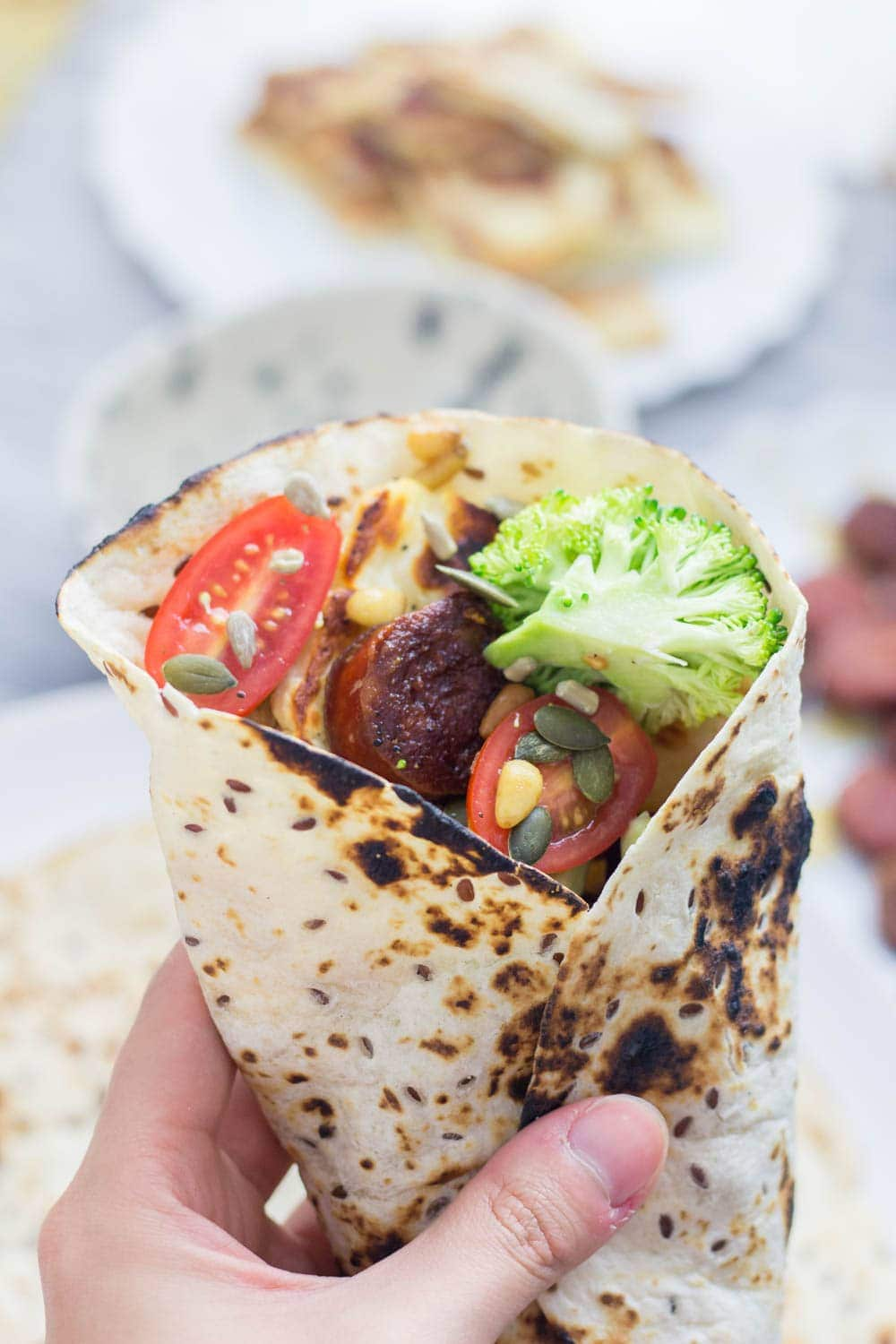 Halloumi & chorizo wraps are such a tasty lunch or dinner. The halloumi & chorizo are wrapped with a fresh broccoli slaw and a sprinkling of nuts and seeds.