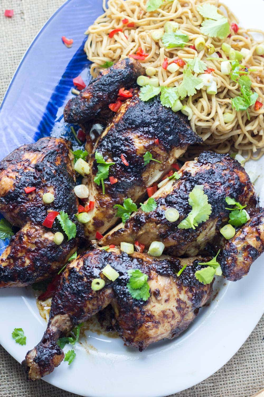 Asian Roasted Spatchcock Chicken with Noodle Salad. This Asian roasted spatchcock chicken is a great way to mix up a roast dinner. I love mine served with a refreshing noodle salad. #roastchicken #recipe #asianfood #spatchcock