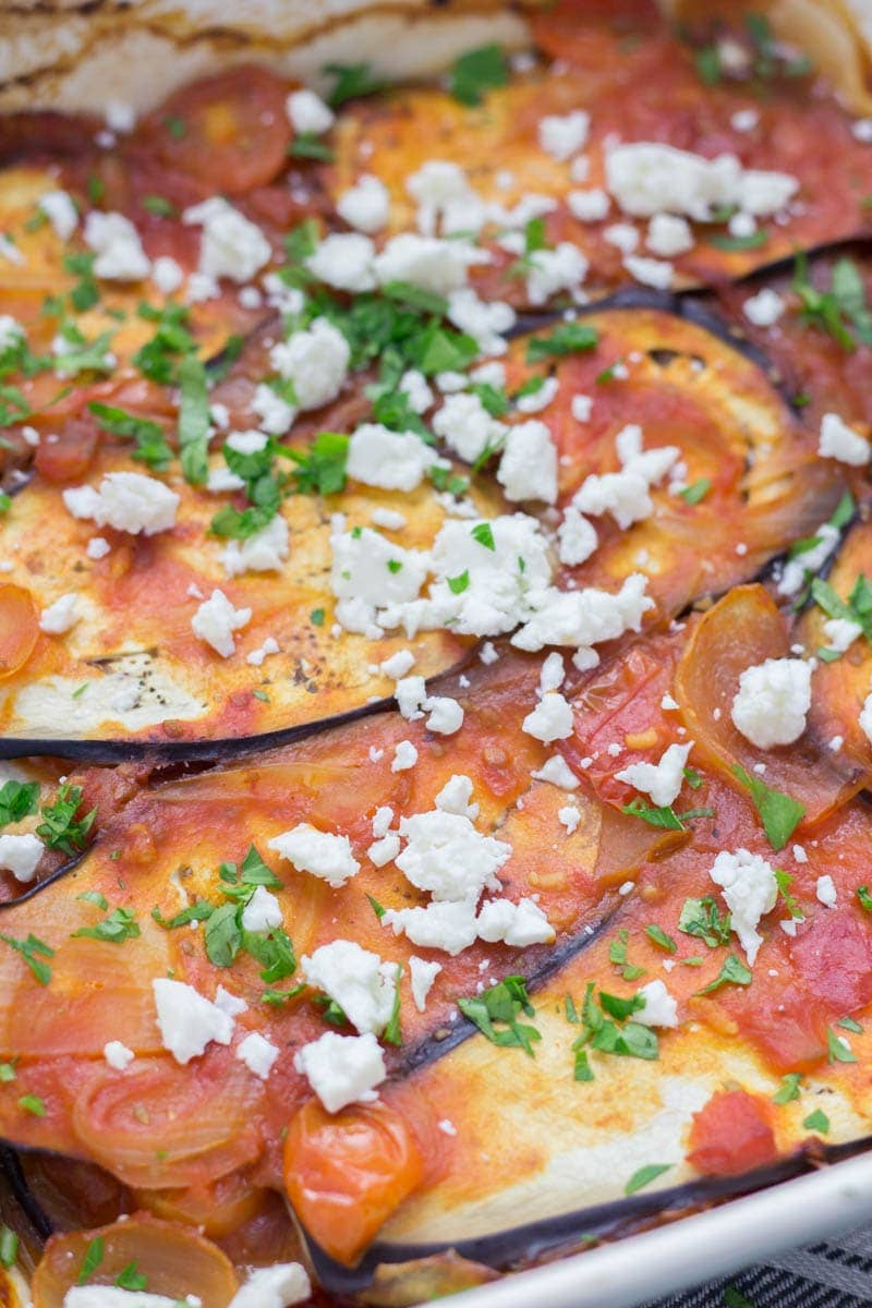 Baked Aubergine in Tomato Sauce. This baked aubergine in tomato sauce recipe is a wonderful vegetarian dinner. Serve with a hunk of crusty bread and a side salad for a filling meal. #vegetarian #recipe #dinner
