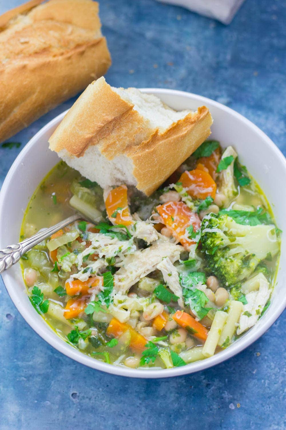 This chicken vegetable soup is a filling and tasty dinner perfect for cold evenings. Serve with some crusty bread and a sprinkling of parmesan.
