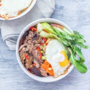 Japanese roast duck legs are shredded and served over sticky rice with pak choi, chilli and perfectly soft fried egg for a tasty dinner all in one bowl! #japanese #duck #roastduck #recipe #healthyrecipe