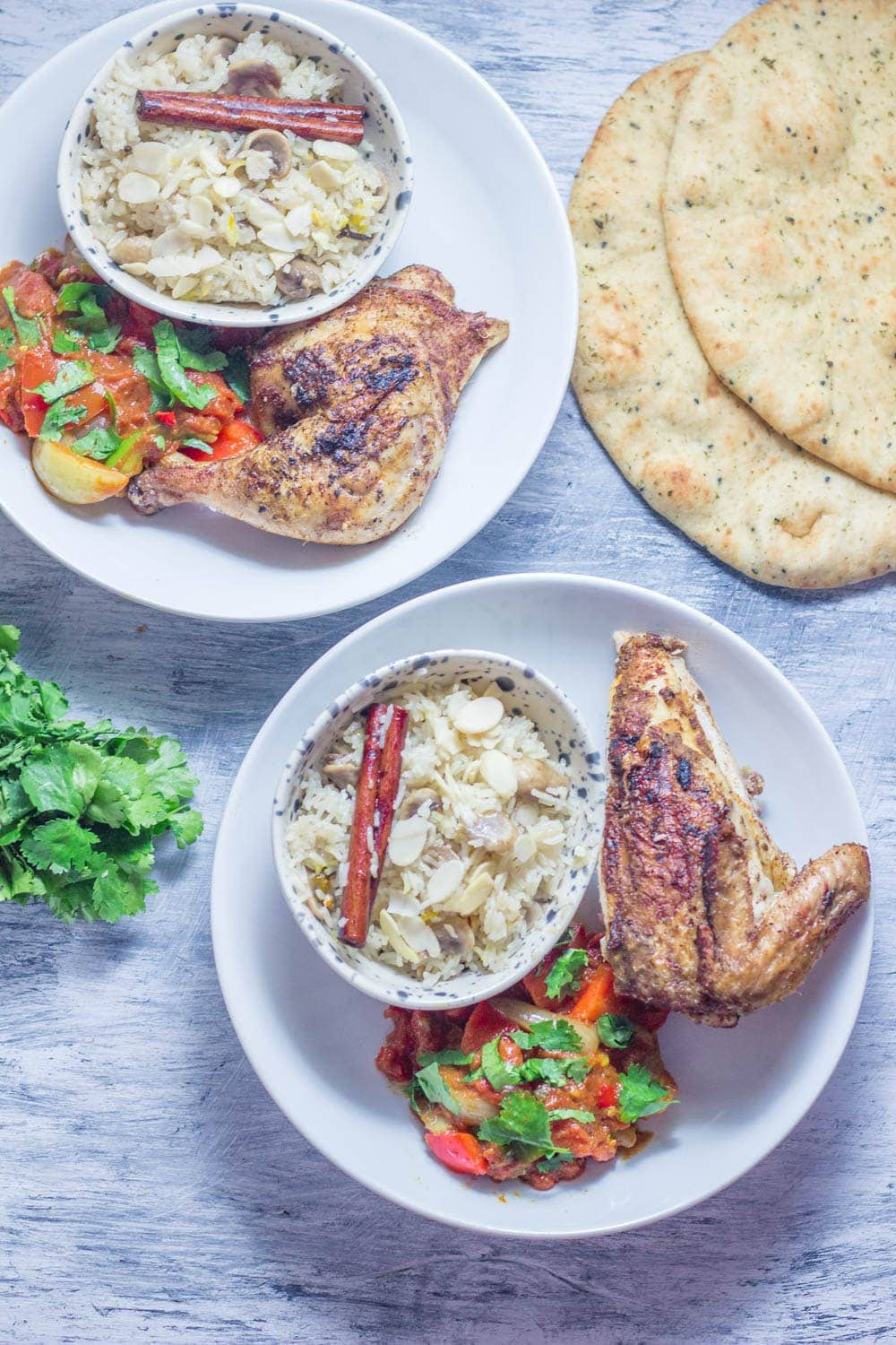 This spiced chicken with jalfrezi sauce is a fun way to mix up your roast dinner! Serve with a helping of mushroom rice to warm you up this winter. #chicken #dinner #indianfood #jalfrezi #roastdinner