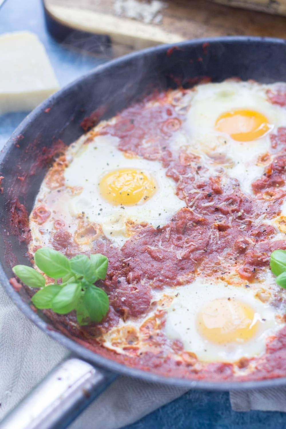 Serve up a hearty breakfast with this Italian shakshuka. Made with a delicious oregano tomato sauce and finished with a sprinkling of parmesan. #shakshuka #recipe #breakfast #brunch #italianfood