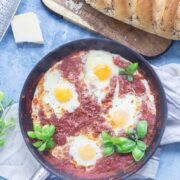 Serve up a hearty breakfast with this Italian twist on a shakshuka made with a delicious oregano tomato sauce and finished with a sprinkling of parmesan. #shakshuka #recipe #breakfast #brunch #italianfood