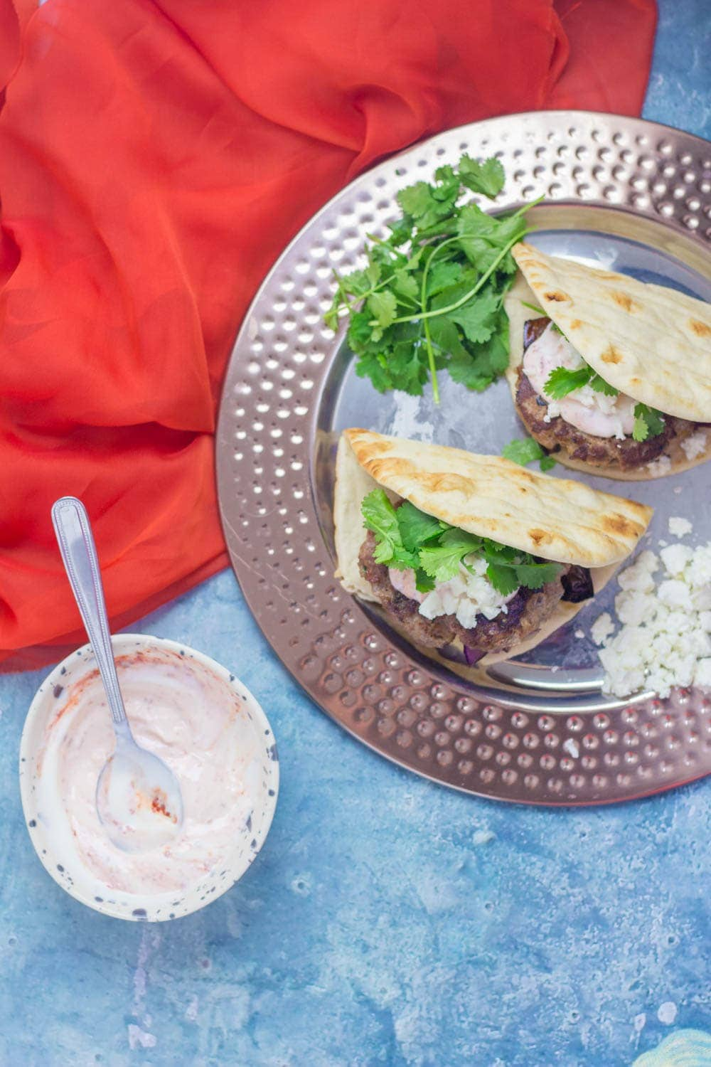 If you need a quick weeknight dinnerthat's guaranteed to impress then this Moroccan lamb burger flatbread recipe is what you need!#lamb #burger #dinner #recipe
