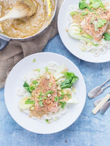 Peanut Salmon Udon Noodles with Pak Choi. The sauce on this peanut salmon is to die for! Perfectly flaky salmon sits on top of udon noodles and wilted pak choi with a creamy peanut sauce. #salmon #udonnoodles #recipe #dinner