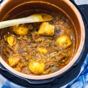 Pressure Cooker Curry with Potato & Aubergine. You won't believe how quick and easy this pressure cooker curry is! It's perfect for an instant pot or any electric pressure cooker. Serve with rice for a healthy vegetarian dinner. #curry#pressurecooker #instantpot #vegetarian #curry