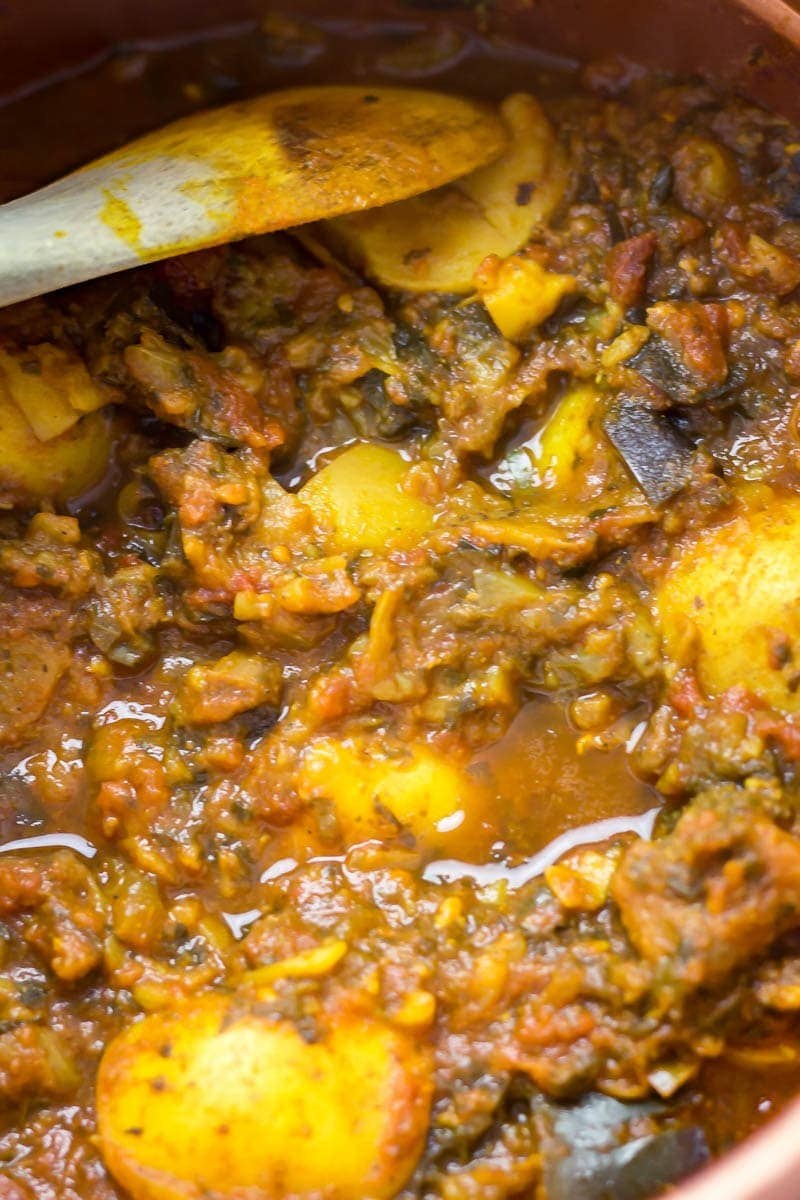 Close up of pressure cooker curry with wooden spoon