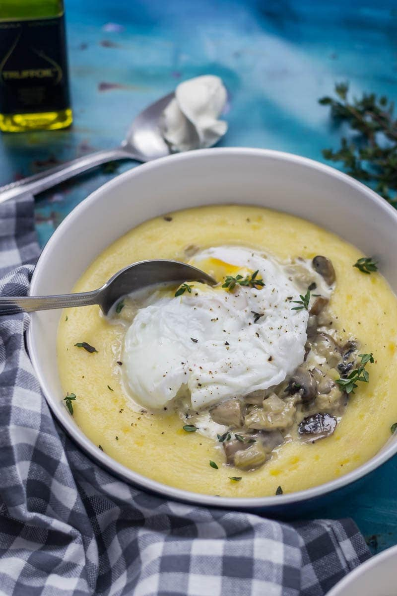 Creamy Mushrooms with Mascarpone Polenta. These creamy mushrooms over indulgent marscarpone polenta are just as good for a winter weeknight dinner as they are for a romantic Valentine's meal. Serve with a poached egg on top for an amazing vegetarian feast. #polenta #recipe #vegetarian #mushroom #creamymushrooms