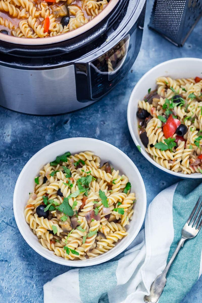 Pressure cooker pasta in two bowls with vegetables and topped with parsley