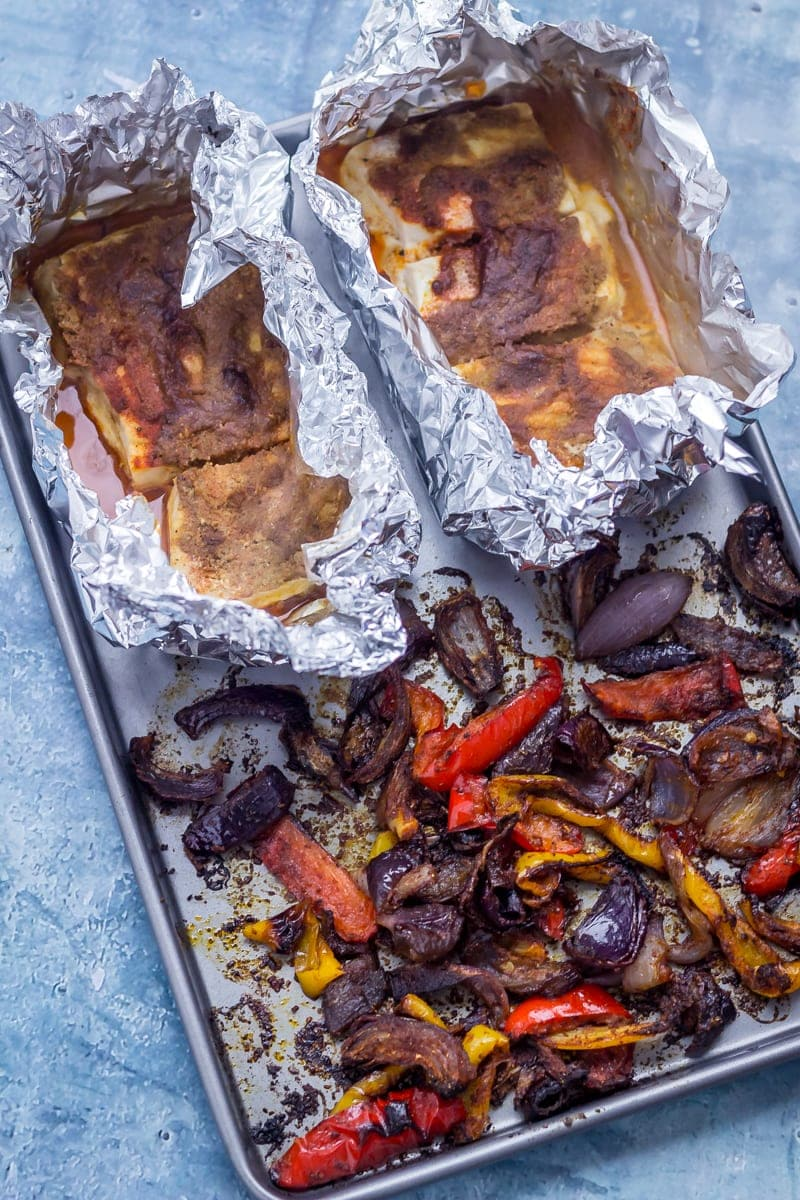 Sheet pan with fish, peppers and onion