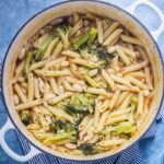 Broccoli and White Bean One Pot Pasta on a blue background