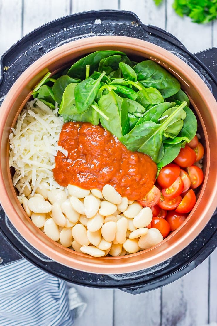 Ingredients for One Pot Cheesy Pearl Barley with Tomatoes in a pressure cooker