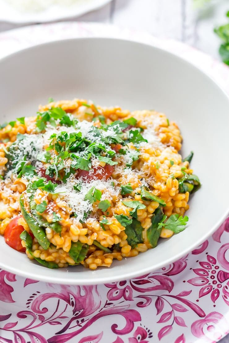 Bowl of One Pot Cheesy Pearl Barley with Tomatoes