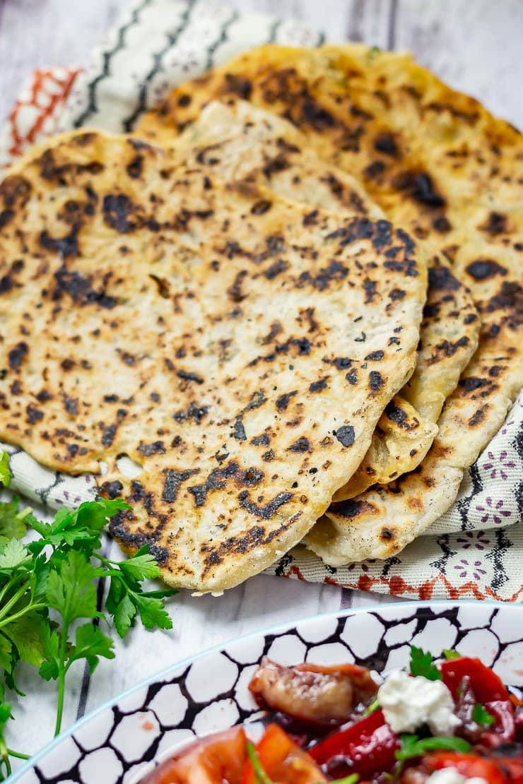 Turkish flatbread on a white wooden background