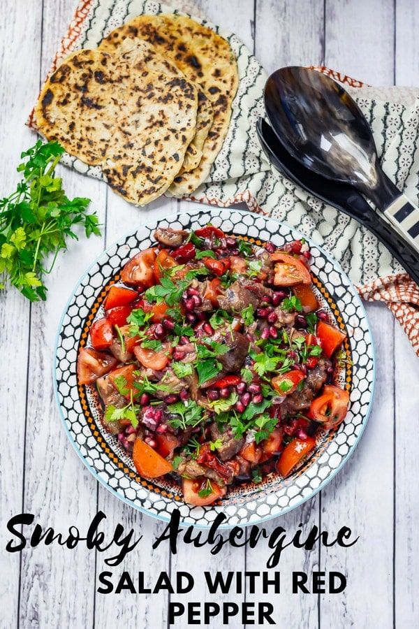 Aubergine and red pepper are cooked over an open flame to make this aubergine salad full of smoky flavour. After the vegetables are cooked they're dressed with a mixture of pomegranate molasses and sumac and tossed with tomatoes for the perfect summer salad!