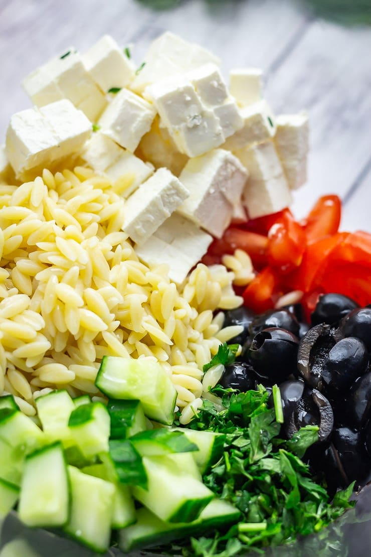 Close up of ingredients for Greek Orzo Salad with Lemon Dressing