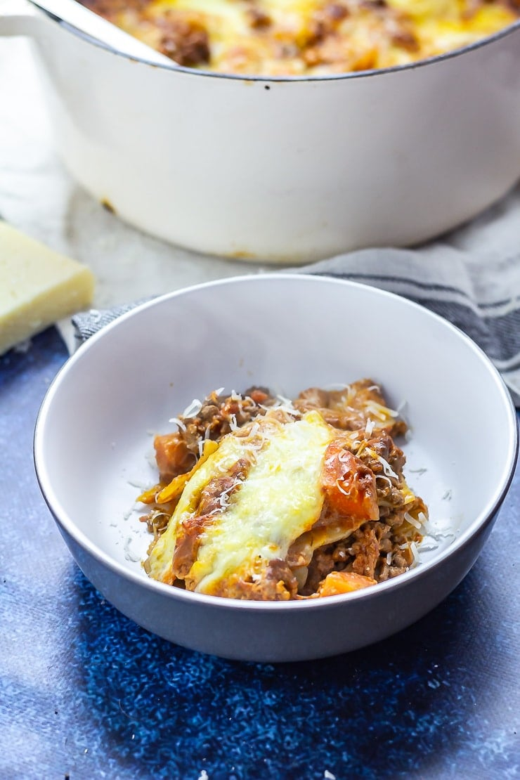 Serving of One Pot Lasagne in a bowl on a blue background