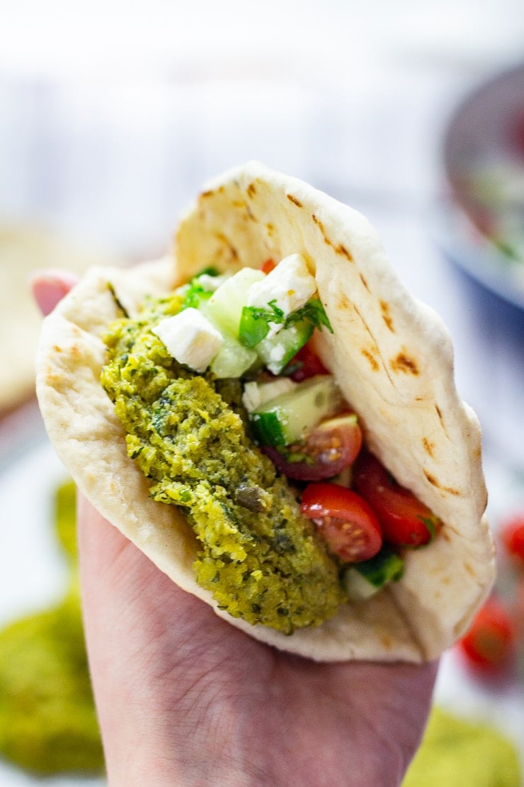 Baked falafel in a flatbread with cucumber, tomato and feta