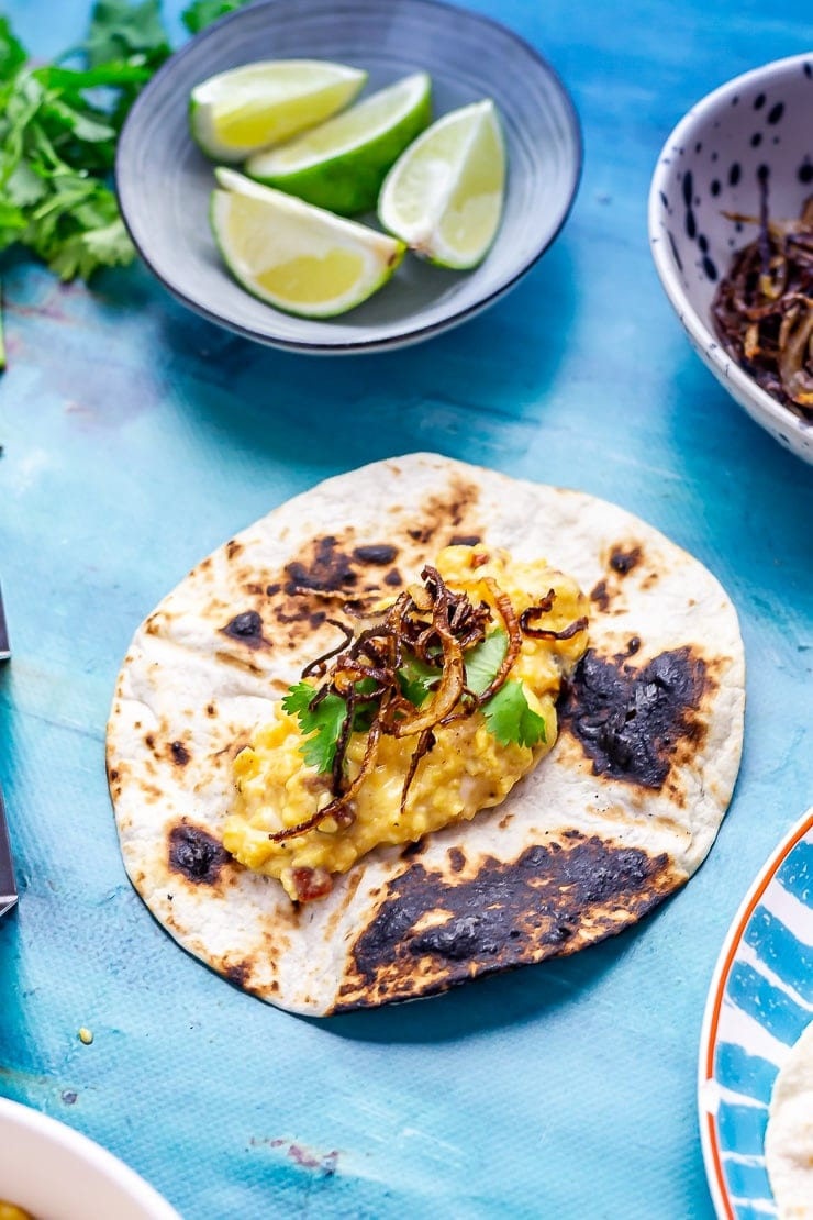 Breakfast tacos on a blue backround