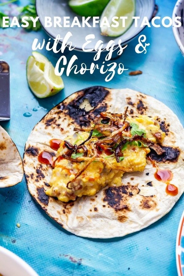 Breakfast tacos are here to make your morning shine! Soft and cheesy scrambled egg, smoky chorizo and crispy onions all folded into a soft tortilla. #breakfast #brunch #recipe #mexicanfood #tacos #breakfasttacos #thecookreport