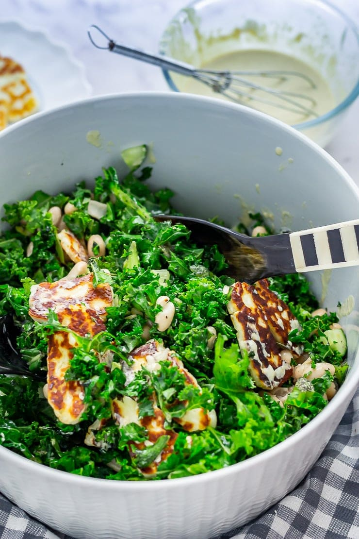 Halloumi salad with kale with salad servers
