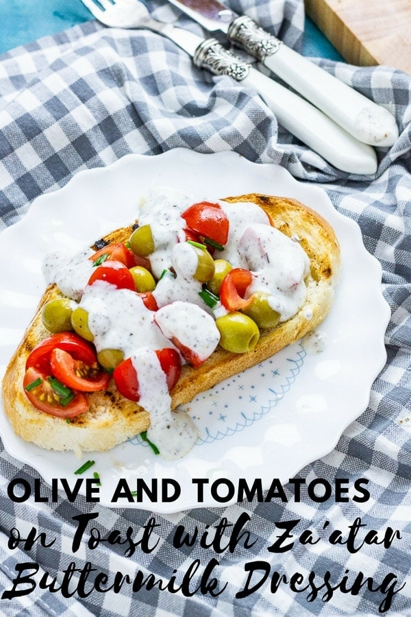 Move over avocado toast! It's time for olive and tomatoes on toast with a creamy za'atar buttermilk dressing for breakfast, lunch and dinner. #snack #lunch #vegetarian #toastrecipe #recipe #thecookreport