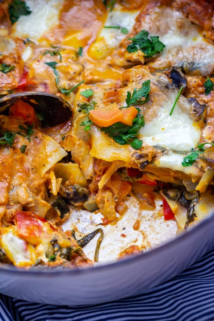 One pot vegetarian lasagne with a portion taken