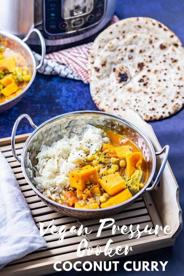 This creamy coconut curry  is so easy and packed with healthy ingredients like sweet potato, broccoli and chickpeas! Plus it's made in the pressure cooker or instant pot and it's suitable for vegans. #curry #pressurecookercurry #pressurecooker #pressurecookerrecipe #instantpot #curryrecipe #thecookreport